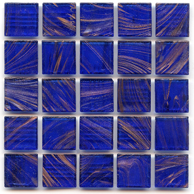 copper swirls accent the cobalt blue mosaic tiles